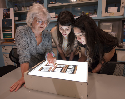 image of 3 women looking at lantern slides