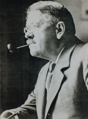 black and white profile of George Reisner, ARCE founder and archaeologist, with his pipe