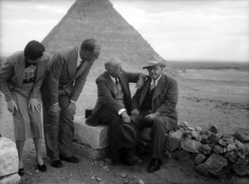 old black and white photograph of Joseph Lindon Smith and George Reisner, plus another unknown man and an unknown woman, in front of the Giza Pyramids