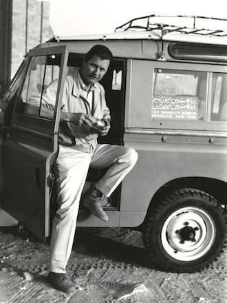 old black and white photograph of Bernard V. Bothmer stepping out of a car in Saqqara, 1969